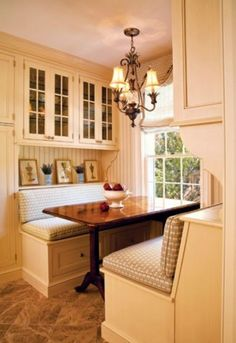 Breakfast nook ~ this is lovely with all the yellow and light, the chandelier above the table, and the storage. #BreakFast #Nook #Kitchen #Home  #IrvineHome  ༺༺  ❤ ℭƘ ༻༻