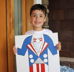 Fun photo prop for 4th of July - make the Uncle Sam costume and have guests hold it.