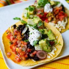 Black beans and avocado vegan tacos with a jicama, cilantro and red grape slaw.