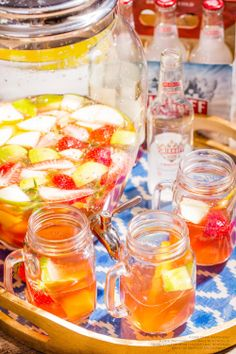 Keep it easy and cute with some Simple Smirnoff Ice Think Pink Sangria! 2 cups Butterfly Kiss Pink Pinot Grigio and a 2 cups Smirnoff Ice Original with apples, peaches, mangos, pears, and strawberries for garnish. Fill a large pitcher with Smirnoff Ice Original, Pinot Grigio, and ice. Add fresh fruit to soak. (6 servings)