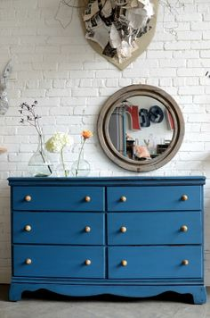 This peacock blue dresser would make a standout sideboard.     can make one of these with the old furniture