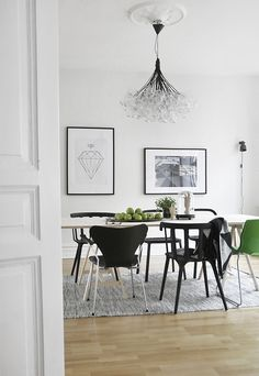 modern chandelier & mis-matched chairs