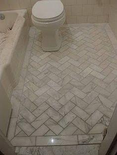 Herringbone pattern marble floor.