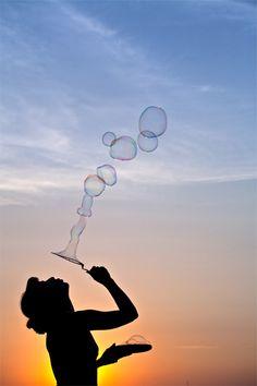 Blowing bubbles | orange & blue