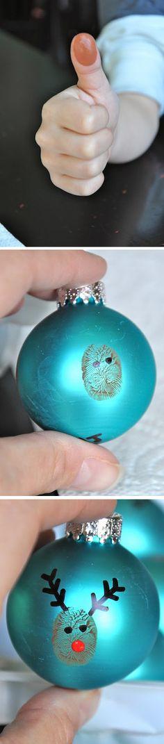 Make a thumbprint reindeer.