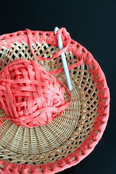 I love the idea of sprucing up an old basket with yarn!