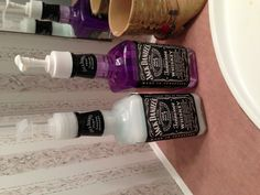 I reused our old liquor bottles for soap & lotion dispensers in the bathroom! Got the soap and lotion at The Dollar Tree poured them into the bottles and used the dispenser tops from the dollar tree bottles.