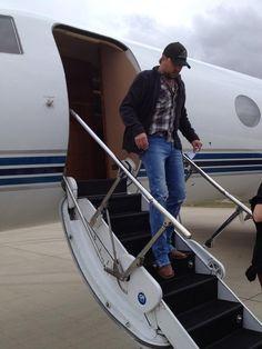 Off the plane to promote his new album Night Train