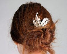messy bun with faux feathers.