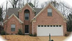 Cathedral two story family room adds space to this 3 bedroom Colonial style home.  Colonial House Plan # 651031.