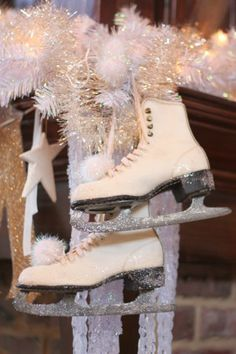 Let's go ice skating! Vintage ice skates that I frosted with glitter and added a pom pom near the toe. It's hung with tinsel from my mantle. #white Christmas #vintage Christmas #ice #snow ...come visit my blog @www.sugarpiefarmhouse.com