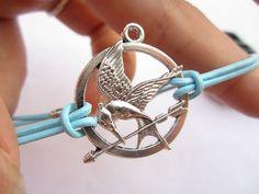 Mockingjay inspired Bracelet---antique silver The hunger game style pendant & alloy chain. $3.99, via Etsy.