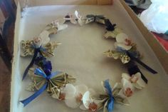 white orchid lei with money origami butterflies, hearts and flowers..made a great graduation gift for my grandaughter!