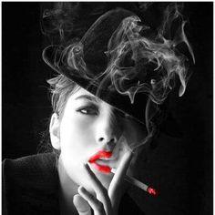 Beautiful woman smoking a cigarette  colors   http://socialsmoking.com if you smoke.