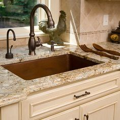 love everything...the cabinets, counter, backsplash, sink, and even the fixtures!
