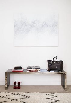 A bench in place of console table | Domino Magazine