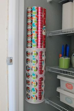 Wrapping paper storage is a $1.50 plastic bag holder from IKEA. Good idea
