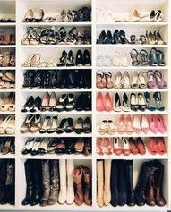 Just cheap white bookcases stacked next to one another for shoe storage!! Must do this!