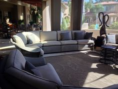 Outdoor cushions recovered in Sunbrella fabrics by Garcia Furniture Designs.