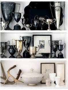 display vintage trophy cups, alabaster, antlers and ironstone