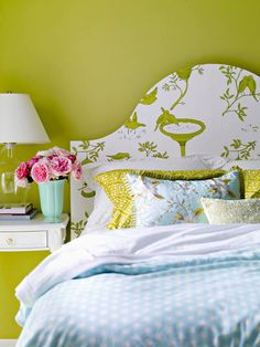 DIY headboard: cut a shape out of wood and wallpaper