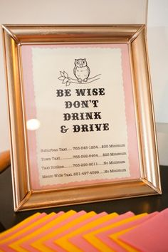 "A great idea if alcohol is being served at your wedding: a framed ""Don't Drink & Drive"" sign with local taxi numbers"