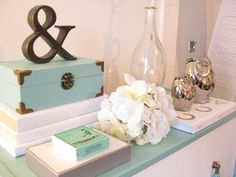 Soft colors and delicate flowers add a feminine touch to your vanity! #HomeInspiration