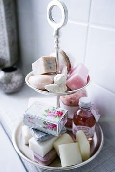 Cake tray bathroom storage. Except with glass jars on the bottom (makeup, cotton balls, etc.) and stray jewelry and hair ties on top