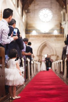 Love this! Cute little girl watching the bride walk down the aisle - photo by Hilary Cam Photography | via junebugweddings.com