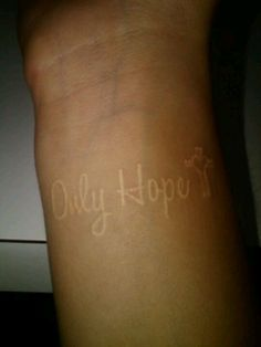 White ink tattoo.