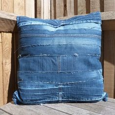 http://naturalmoderninteriors.blogspot.com.au/2013/08/recycled-fabric-cushion-ideas.html | Recycled Fabric Cushion Ideas made from strips of denim and denim off-cuts.