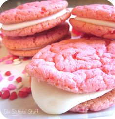 Strawberry Valentine Oreo Cookies.  These are the perfect treat for your Valentine!  Cookies:  1 package of strawberry cake mix  2 eggs  3/4 cup of shortening    Frosting:  8 oz. cream cheese, room temperature  1/2 stick of butter, softened  2 tsp. vanilla  4 c. powdered sugar