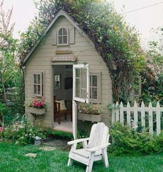 What a sweet garden cottage. White picket fence, flower boxes at the window...