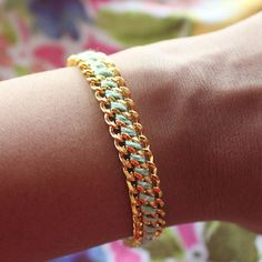 The Floss and Chain Embroidered Bracelet takes mixed media to new levels of delicate glamor. By using embroidery thread to connect jewelry chain, this DIY bracelet sets itself apart from other woven bracelet patterns.