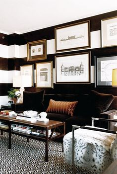 black wall with white stripes. Striped wall and art in living room. #decor #classic #style #interior #sofa #books