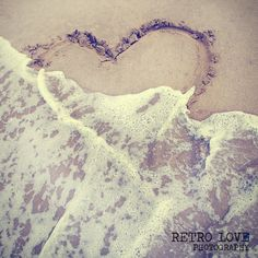 Sand writing heart