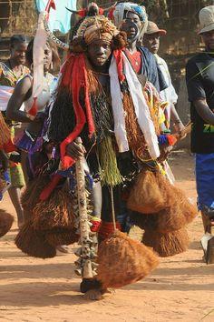 Bijago girl in her traditional initiation regalia.
