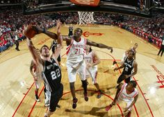 Samuel Dalembert stuffs Tiago Splitter of the Spurs
