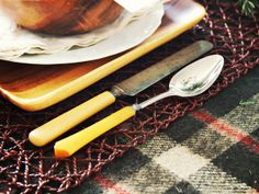 Mix and Match: Vintage Bakelite flatware from slightly mismatched sets looks perfect side by side. Don't be afraid to mix and match silverware, plates and glasses. It often looks more interesting than using pieces that are made to be a set.