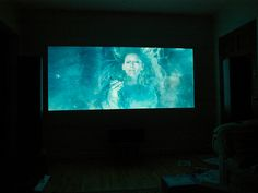 Media Room: Projector wall paint: 70% Behr Silver Screen and 30% Behr White Opal Pearlescent