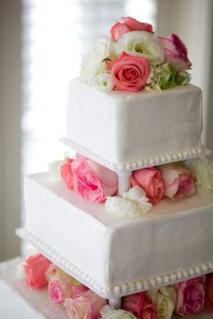 Tiered white wedding cake with flowers