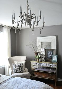 Mirrored dresser with white armchair and gray paint by @Jenn L Milsaps L Crotty Holmes - Dear Lillie