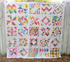 Squares made up of variations using half square triangles and Anna Maria Horner's Good Folks fabric line.