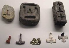 Viking Age molds for making silver pendants--Crucifixes & Mjolnir (Thor's Hammer). The far right mold could be used for making either depending on the customer. Mjolnir pendants only became popular to compete with the crosses worn by those with the new religion at the spread of Christianity.