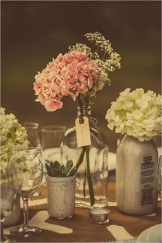 collected glass jars used as centerpieces #weddingflorals #diy #weddingchicks http://www.weddingchicks.com/2014/04/01/diy-palm-springs-wedding/