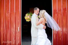 bride groom red barn pose