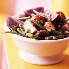 With new potatoes, purple potatoes and green beans, this salad makes a colorful sensation at cookouts and potlucks.