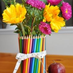 Easy to make vase to give as a teacher gift. The teacher can enjoy the flowers now and use the pencils later.
