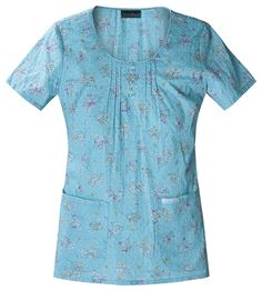 Love the turquoise color with the bits of red! #nurse #fashion #scrubs