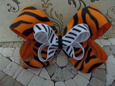 orange tiger stripe an black and white striped hair bow.